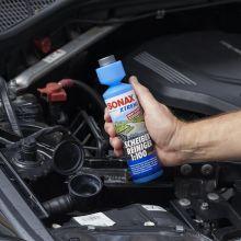 Koncentrat letniego płynu w butelce ze specjalnym dozownikiem
